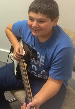 Jacob has fun learning some new songs in his guitar lessons