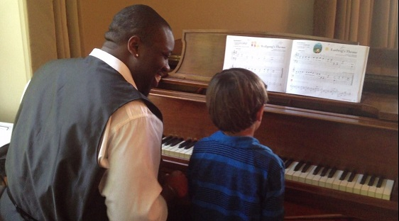 Kamden duets with his piano teacher in our recital