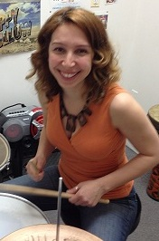 an adult student in her drum lesson