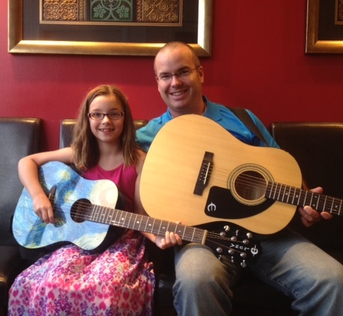 a father & daughter guitar team